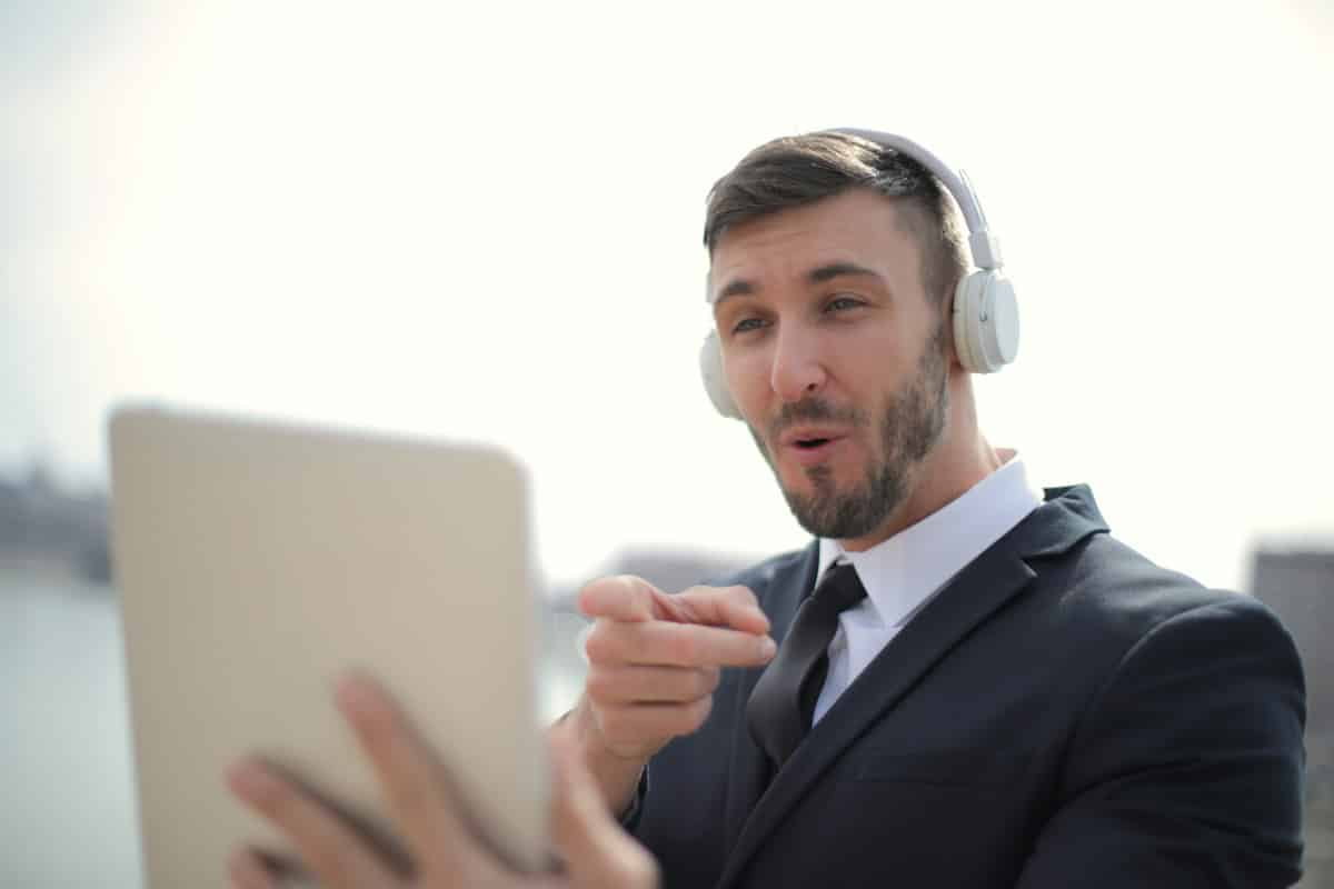 Man using tablet for video call.